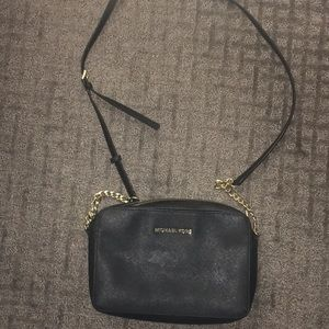 Mickael kors Black crossbody bag. Chain is gold